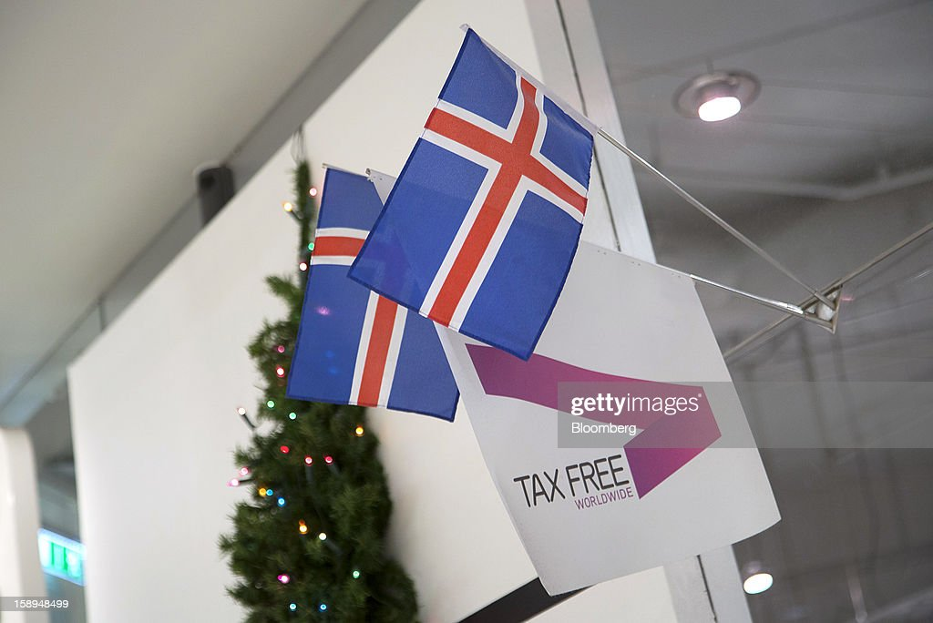 Icelandic national flags hang from a display advertising tax free goods at the Kringlan shopping center in Reykjavik, Iceland, on Wednesday, Jan. 2, 2013. Creditors of Iceland's three biggest failed banks are fighting for a waiver to krona controls imposed in 2008 amid risks pay-outs will be delayed beyond 2015. Photographer: Arnaldur Halldorsson/Bloomberg via Getty Images