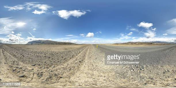 icelandic paved road 26 while sunny summer day with blue sky and white clouds - 360° panorama of automotive scenery. - 全天周パノラマ ストックフォトと画像