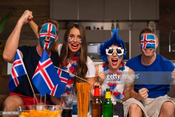 icelandic sports fans in front of tv