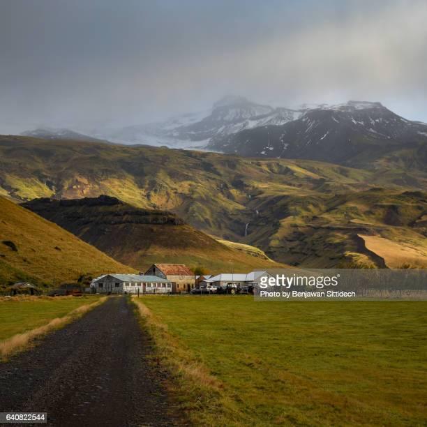 Icelandic village and mountain landscape, Iceland