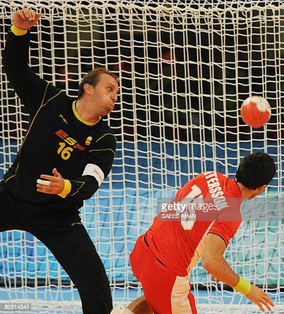 Iceland's Alexander Petersson scores as Spain's goalkeeper David Barrufet looks on during a men's handball semifinal of the 2008 Beijing Olympic...