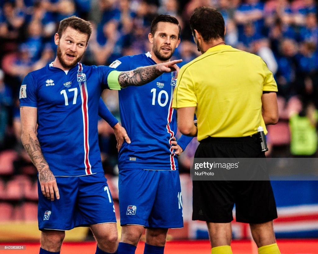 Iceland's Aron Gunnarsson is yellow carded during the FIFA World Cup 2018 Group I football qualification match between Finland and Iceland in Tampere, Finland, on September 2, 2017.