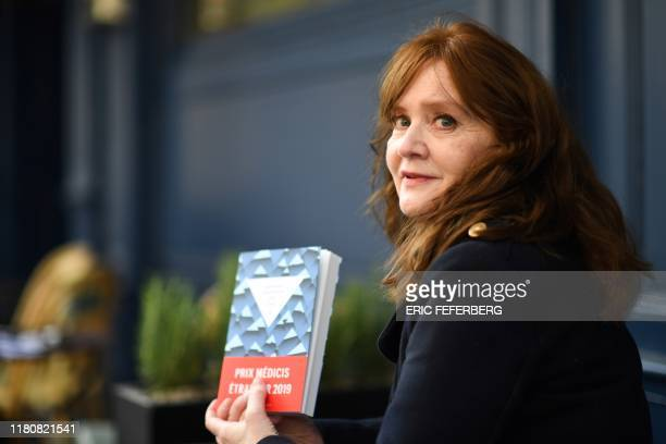 "Iceland's authors Audur Ava Olafsdottir poses with her book ""Miss Iceland"" after receiveing the literary prize Prix Medicis etranger, for foreign..."