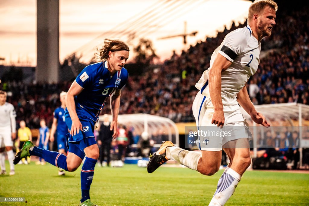 Iceland's Birkir Bjarnason and Finland's Paulus Arajuuri during the FIFA World Cup 2018 Group I football qualification match between Finland and Iceland in Tampere, Finland, on September 2, 2017.
