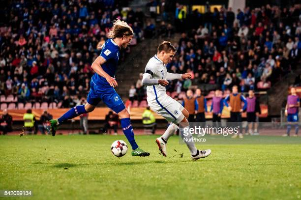Iceland's Birkir Bjarnason and Finland's Robin Lod during the FIFA World Cup 2018 Group I football qualification match between Finland and Iceland in...