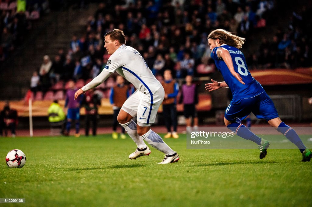 Iceland's Birkir Bjarnason and Finland's Robin Lod during the FIFA World Cup 2018 Group I football qualification match between Finland and Iceland in Tampere, Finland, on September 2, 2017.