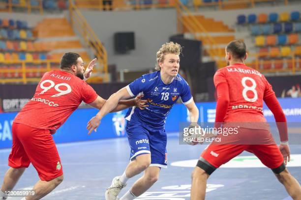 Iceland's centre back Gisli Thorgeir Kristjansson is marked by Morocco's pivot Nabil Slassi and Morocco's centre back Mohamed Amine Bentaleb during...