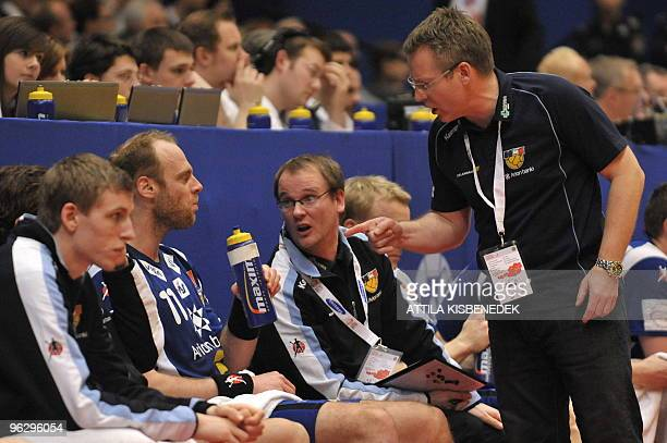 Iceland's coach Gudmundur Gudmundsson gives instructions to his players on January 31 during the EHF EURO 2010 Handball Championship game for the 3/4...