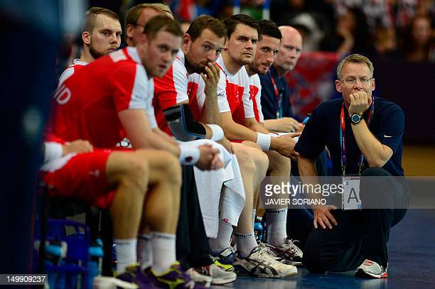 Iceland's coach Gudmundur Gudmundsson looks on during the men's preliminary Group A handball match Iceland vs Great Britain for the London 2012...