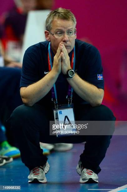 Iceland's coach Gudmundur Gudmundsson looks on during the men's quarterfinal handball match Iceland vs Hungary for the London 2012 Olympics Games on...