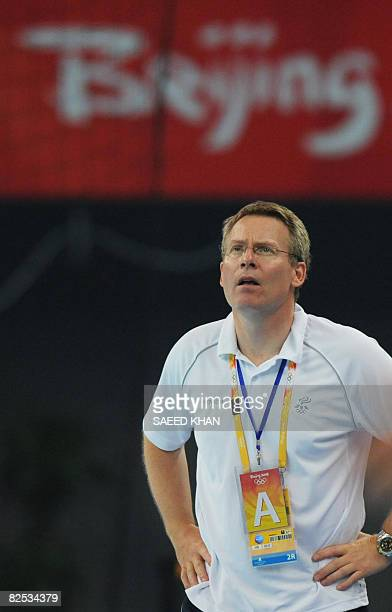 Iceland's coach Gudmundur Th Gudmundsson stands after losing to France in the men's handball gold medal match of the 2008 Beijing Olympic Games on...