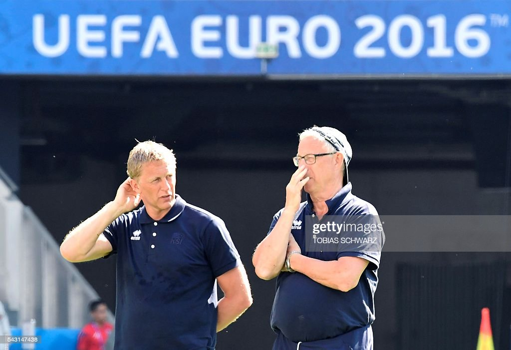 Iceland's coach Heimir Hallgrimsson (L) and Iceland's coach Lars Lagerbaeck watch team players take part in a training session at the Allianz Riviera stadium in Nice on June 26, 2016 on the eve of their Euro 2016 round of 16 football match Iceland vs England. / AFP / TOBIAS