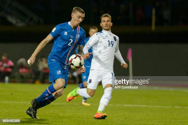Iceland's defender Birkir Saevarsson and Kosovo's Leart Paqarada vie for the ball during the FIFA World Cup 2018 qualification football match between...