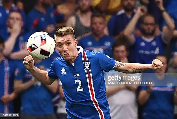 Iceland's defender Birkir Saevarsson plays the ball during Euro 2016 round of 16 football match between England and Iceland at the Allianz Riviera...