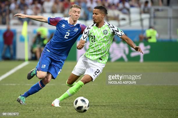 Iceland's defender Birkir Saevarsson vies with Nigeria's defender Tyronne Ebuehi during the Russia 2018 World Cup Group D football match between...