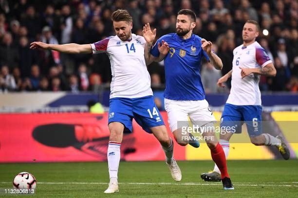 Iceland's defender Kari Arnason and France's forward Olivier Giroud vie for the ball during the UEFA Euro 2020 Group H qualification football match...