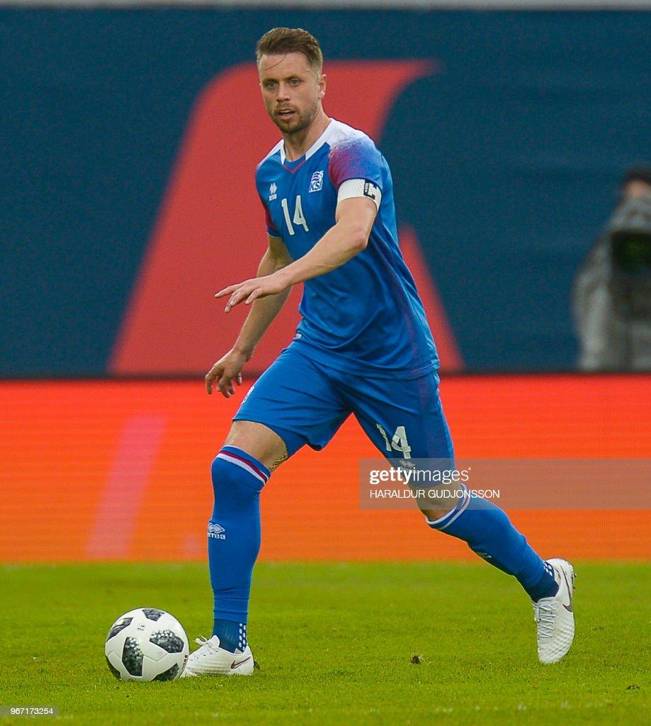 Iceland's defender Kari Arnason plays the ball during the international friendly football match Iceland v Norway in Reykjavik, Iceland on June 2, 2018.