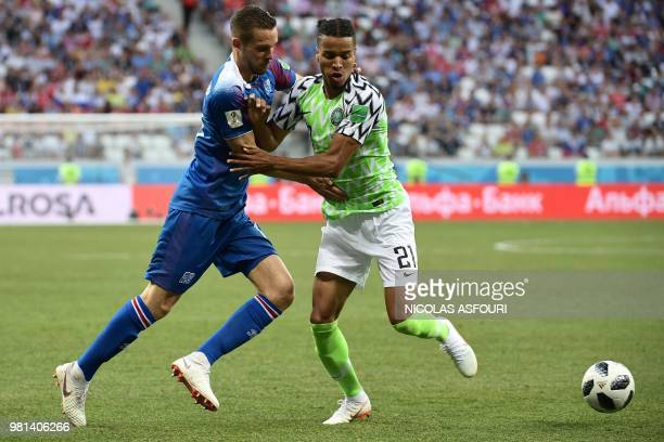 Iceland's defender Kari Arnason vies with Nigeria's defender Tyronne Ebuehi during the Russia 2018 World Cup Group D football match between Nigeria...