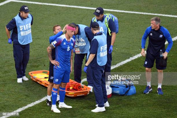 Iceland's defender Ragnar Sigurdsson gets his head bandaged after getting injured during the Russia 2018 World Cup Group D football match between...