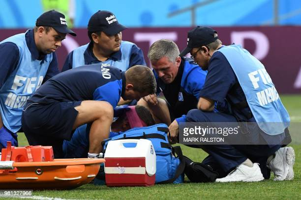 Iceland's defender Ragnar Sigurdsson is treated by medical staff after a collision during the Russia 2018 World Cup Group D football match between...