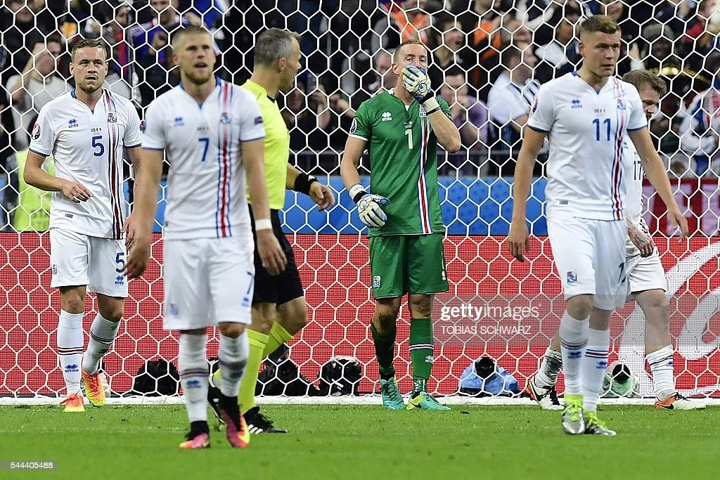 Iceland's defender Sverrir Ingason, forward Johann Berg Gudmundsson,goalkeeper Hannes Thor Halldorsson, forward Alfred Finnbogason and midfielder Aron Gunnarsson reacts following a goal during the Euro 2016 quarter-final football match between France and Iceland at the Stade de France in Saint-Denis, near Paris, on July 3, 2016. SCHWARZ