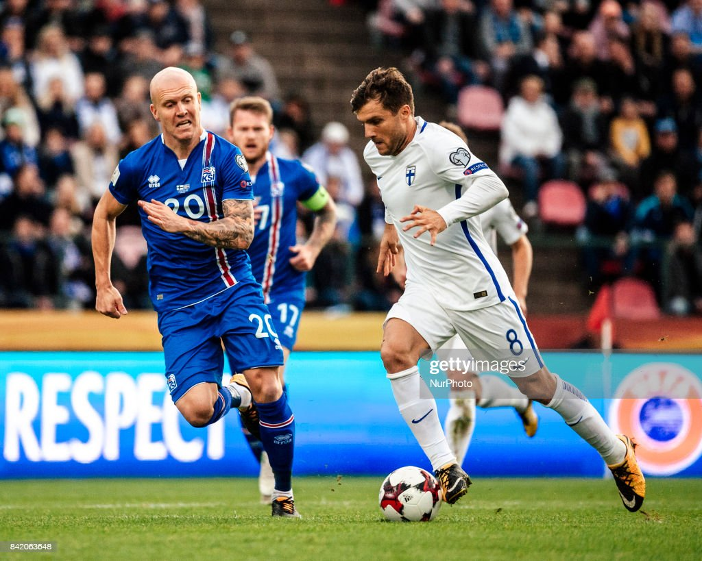 Iceland's Emil Hallfredsson and Finland's Perparim Hetemaj fight for the ball during the FIFA World Cup 2018 Group I football qualification match between Finland and Iceland in Tampere, Finland, on September 2, 2017.
