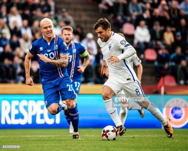 Iceland's Emil Hallfredsson and Finland's Perparim Hetemaj fight for the ball during the FIFA World Cup 2018 Group I football qualification match...