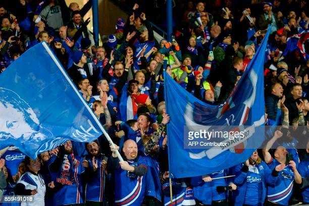 Iceland's fans celebrates at the FIFA World Cup 2018 qualification football match between Iceland and Kosovo in Reykjavik Iceland on October 9 2017...