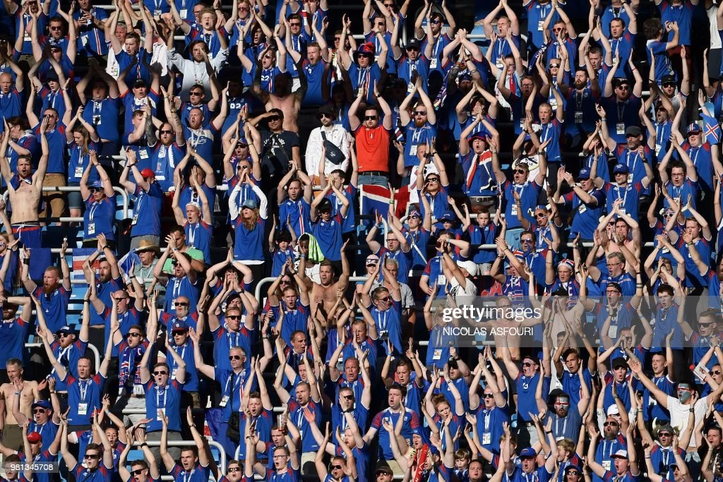 Iceland's fans cheer their team before the Russia 2018 World Cup Group D football match between Nigeria and Iceland at the Volgograd Arena in Volgograd on June 22, 2018. (Photo by NICOLAS ASFOURI / AFP) / RESTRICTED