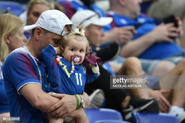 Iceland's fans react after being defeated by Nigeria at the end of the Russia 2018 World Cup Group D football match between Nigeria and Iceland at...