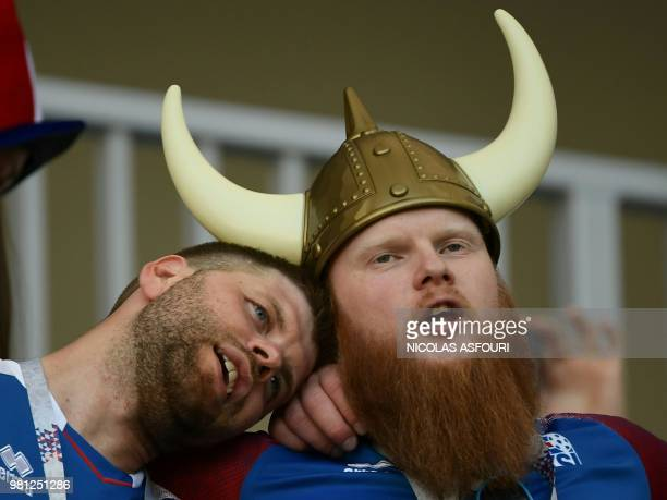 Iceland's fans sporting a fake Viking helmet shout as they wait in the grandstand before the Russia 2018 World Cup Group D football match between...