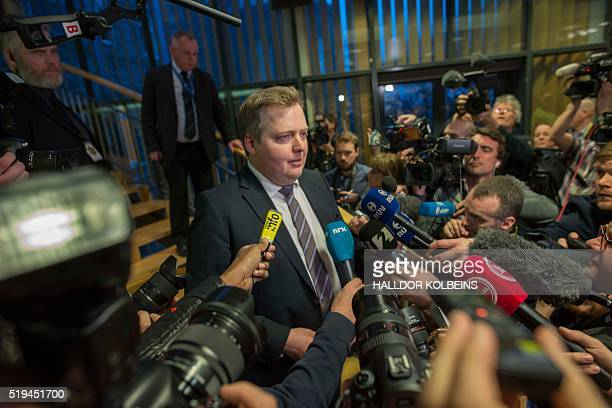 Iceland's former Prime Minister Sigmundur David Gunnlaugsson makes his way past a media scrum after the new prime minister was announced in the...