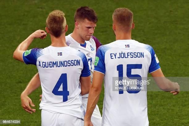 Iceland's forward Albert Gudmundsson Iceland's midfielder Johann Gudmundsson and Iceland's defender Holmar Eyjolfsson react at the end of the Russia...