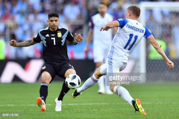 Iceland's forward Alfred Finnbogason challenges Argentina's midfielder Ever Banega during the Russia 2018 World Cup Group D football match between...
