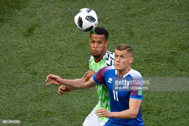 Iceland's forward Alfred Finnbogason challenges Nigeria's defender William Troost-Ekong during the Russia 2018 World Cup Group D football match...
