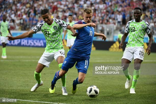Iceland's forward Alfred Finnbogason vies with Nigeria's defender Tyronne Ebuehi and Nigeria's defender Kenneth Omeruo during the Russia 2018 World...