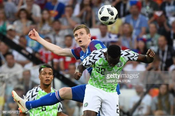Iceland's forward Jon Bodvarsson heads the ball with Nigeria's defender Kenneth Omeruo during the Russia 2018 World Cup Group D football match...