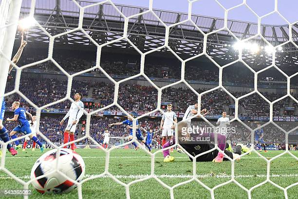 Iceland's forward Kolbeinn Sigthorsson celebrates after scoring Iceland's second goal during Euro 2016 round of 16 football match between England and...