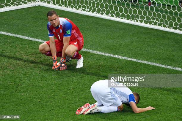 TOPSHOT Iceland's goalkeeper Hannes Halldorsson and Iceland's defender Ragnar Sigurdsson react after Croatia's goal during the Russia 2018 World Cup...