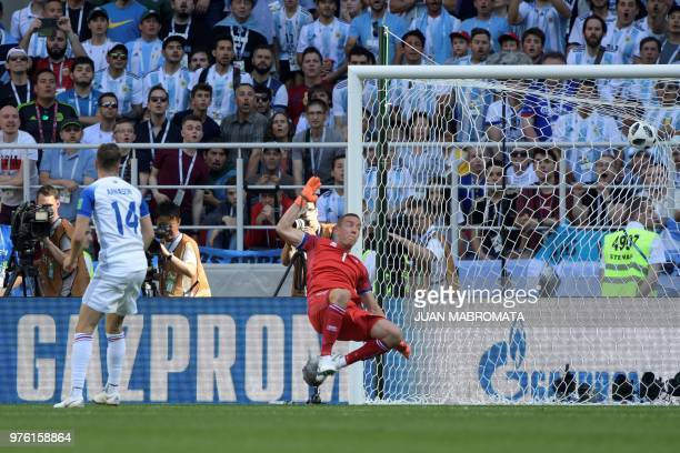 TOPSHOT Iceland's goalkeeper Hannes Halldorsson concedes the opening goal during the Russia 2018 World Cup Group D football match between Argentina...