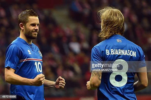 Iceland's Gylfi Sigurdsson and Birkir Bjarnason celebrate after Sigurdsson scored a penaly against Poland during the international friendly football...