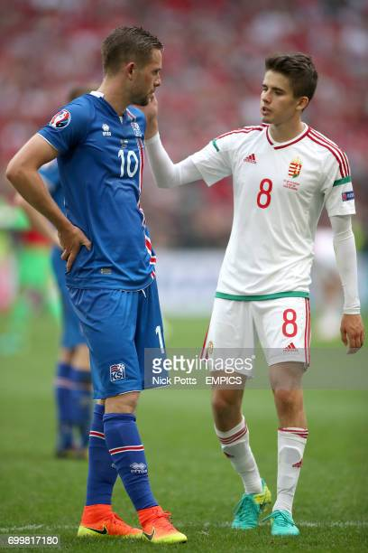 Iceland's Gylfi Sigurdsson is consoled by Hungary's Adam Nagy after the final whistle