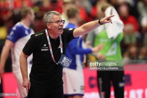 Iceland's head coach Gudmundur Gudmundsson reacts during the Men's European Handball Championship preliminary round Group E match between Iceland and...