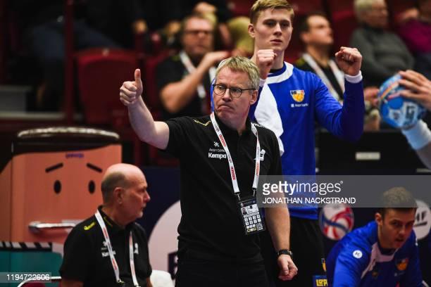 Iceland's head coach Gudmundur Gudmundsson reacts during the Men's European Handball Championship main round match between Portugal and Iceland in...