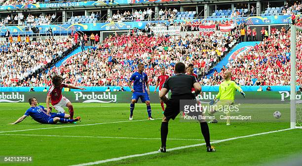 Iceland's Jon Dadi Bodvarsson scores his sides first goal during the UEFA Euro 2016 Group F match between Iceland and Austria at Stade de France on...