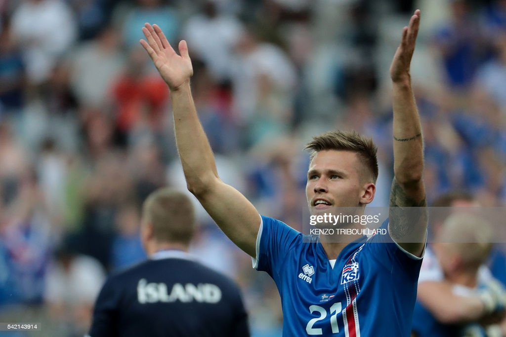 Iceland's midfielder Arnor Ingvi Traustason celebrates after the Euro 2016 group F football match between Iceland and Austria at the Stade de France stadium in Saint-Denis, near Paris on June 22, 2016. /