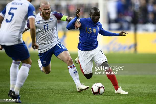 Iceland's midfielder Aron Gunnarsson and France's midfielder N'Golo Kante vie for the ball during the UEFA Euro 2020 Group H qualification football...