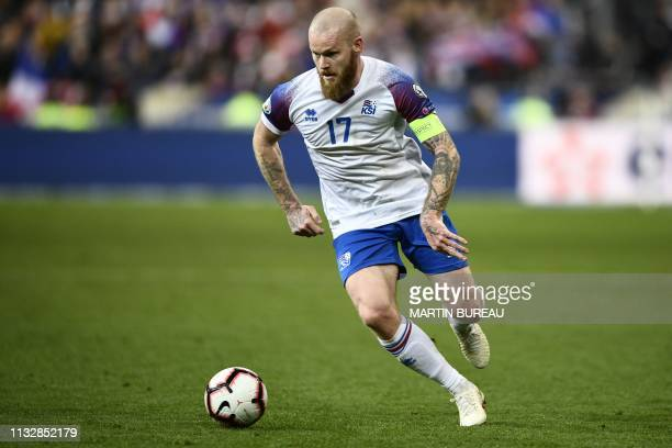 Iceland's midfielder Aron Gunnarsson controls the ball during the UEFA Euro 2020 Group H qualification football match between France and Iceland at...