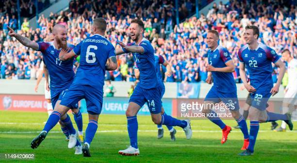 Iceland's midfielder Aron Gunnarsson, Iceland's defender Ragnar Sigurdsson, Iceland's defender Kari Arnason,Iceland's defender Hjortur Hermannsson...