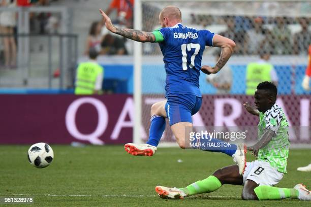 Iceland's midfielder Aron Gunnarsson vies with Nigeria's midfielder Oghenekaro Etebo during the Russia 2018 World Cup Group D football match between...
